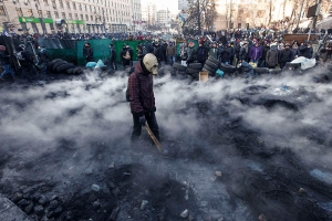 Pro-European integration protesters gather at the site of clashes with riot police in Kiev